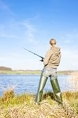 pic of fisherwomen  - woman fishing at a pond - JPG