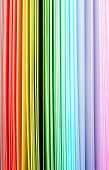 stock photo of end rainbow  - Rainbow color spectrum of thick paper ends from red to purple - JPG