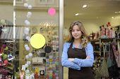 picture of self-employment  - small business owner in front of gift store - JPG