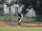 PUCHONG, MALAYSIA - SEPT 24: Guernsey's batsman Jeremy Frith hits at the ball in this Pepsi ICC Worl