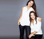 Cute Pretty Teen Daughter With Mature Mother Hugging, Fashion Style Brunette, Lifestyle People Conce poster