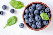 Fresh Blueberries In Bowl On White Background, Top View. Juicy Ripe Blueberries. Blueberries Isolate poster