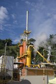 image of biogas  - Steam Rises From A Smokestack On a Factory - JPG