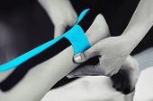 Achilles Tendon Treatment With Blue Kinesiology Tape poster