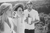 Macho Or Man With Champagne Bucket. Blur Girls Or Women Drinking White Wine. Winery Tour And Picnic. poster
