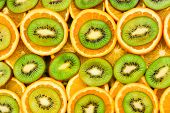 Fruity Background Set Of Slices Of Orange Fruit And Kiwi. Many Slices Of Kiwi Fruit And Orange Fruit poster
