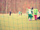 Football Player Stands Against Goal With Net And Stadium. Football Gate Net. Soccer Gate Net.  In Bl poster