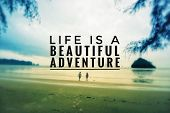 Motivational And Inspirational Quote - Life Is A Beautiful Adventure. With Blurred Vintage Styled Ba poster