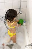 image of clawfoot  - little girl playing in the bathtub - JPG