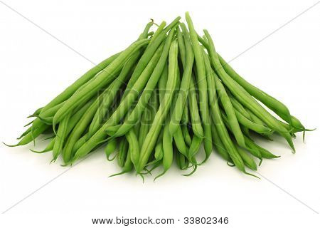small and slender green beans (haricot vert) on a white background