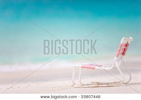 Beach chair at beautiful tropical coast