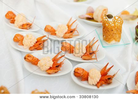 Banquet dish - appetizer made of scampi