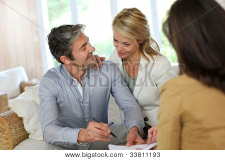 Couple meeting advisor at home