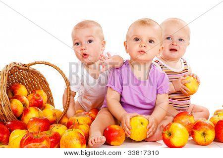 Three adorable babies looking surprised