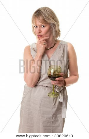 Woman in Thought with Hand to Face Holding Wine Glass