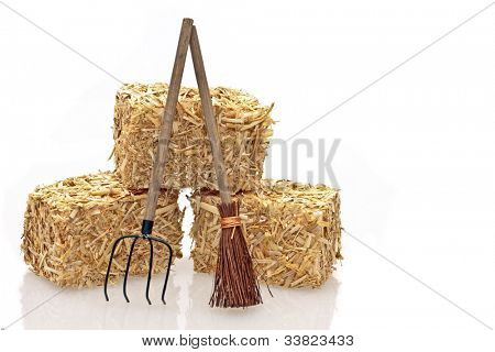 Hay bales with tools on a white background