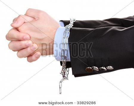 Businessman hands fettered with chain isolated on white