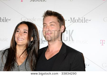 LOS ANGELES - NOV 16:  Emmanuelle Chriqui, Lance Bass arrives at the Google Music Launch at Mr. Brainwash Studio on November 16, 2011 in Los Angeles, CA