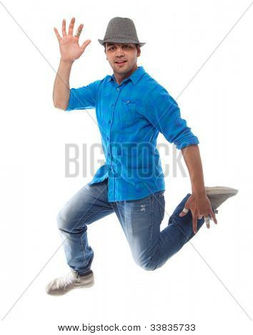 Young caucasian man jumping over isolated white background.
