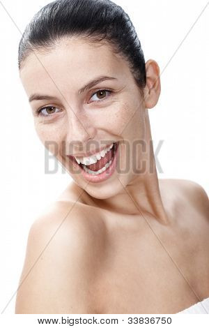 Portrait of natural smiling woman with sunspots.