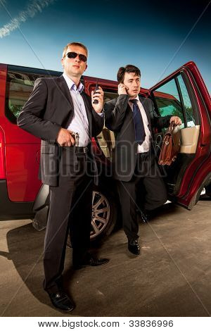 bodyguard and its boss leave the car