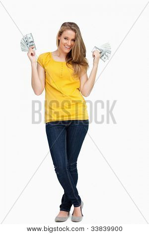 beautiful blonde Woman smiling mit viel Dollar against white background
