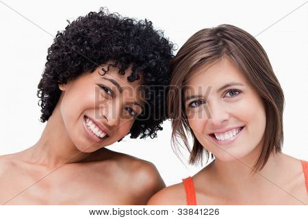 Teenagers smiling and posing against a colourless background