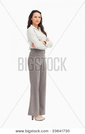 Portrait of a  beautiful employee with folded arms against white background