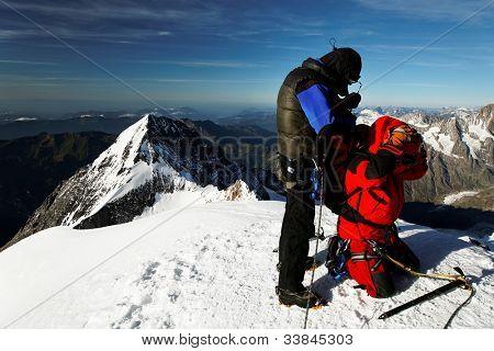 Team of alpinists on Monch Peak  (4107m), Berner Oberland, Switzerland - UNESCO Heritage