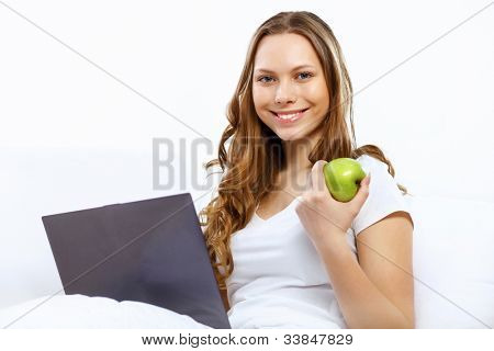 Portrait of young woman sitting with a notebook