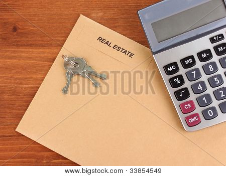 folder with information of real estate on wooden background close-up