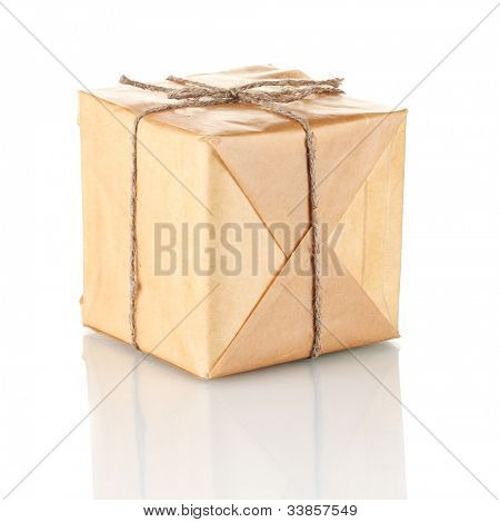 Small parcel wrapped in brown paper tied with twine isolated on white