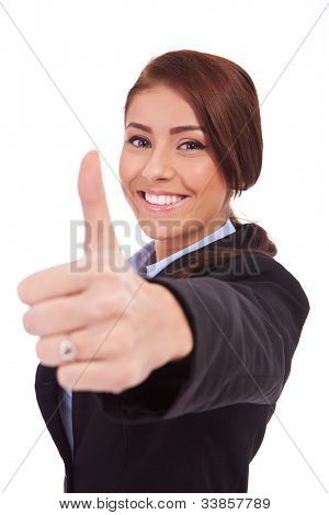 Young business woman making thumb up ok gesture. Isolated over white background