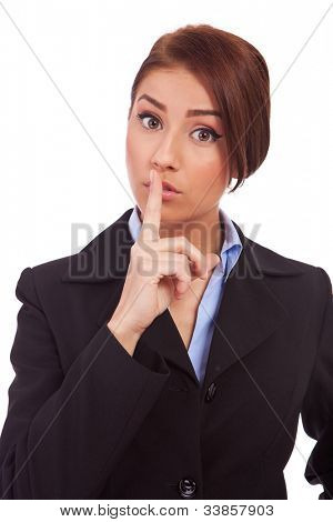 portrait of attractive business woman with finger on lips, making quiet gesture, isolated over white background