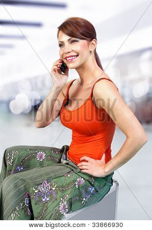 young beautiful girl speaks by mobile phone
