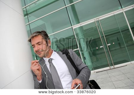 Businessman talking on mobile phone with handsfree headset