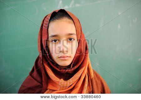 Muslim girl with hijab in school