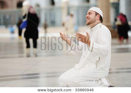 Muslim praying in Medina mosque outdoor