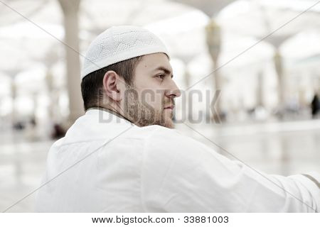 Muslim praying in Medina mosque outdoor