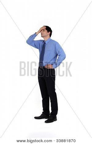 portrait of young businessman having remorse