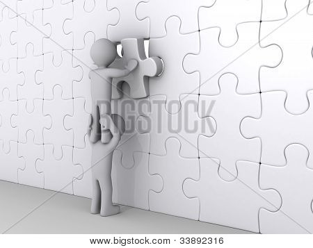 Person On Top Of Another Putting Last Piece Of Puzzle