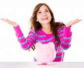 Woman with a piggybank waiting for money to fall - isolated over white