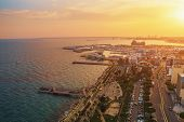 Limassol, Cyprus Aerial Panoramic View At Sunset. Evening Mediterranean Resort Town Or City With All poster
