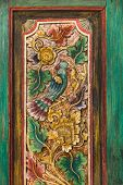 Close-up Details Of Traditional Balinese Handmade Carved Wooden Door. Bali Style Furniture With Flow poster
