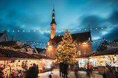Tallinn, Estonia. Traditional Christmas Market On Town Hall Square. Christmas Tree And Trading House poster