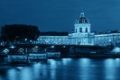 River Seine with Pont des Arts and Institut de France at night in Paris, France. poster