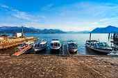 Pier With Boats In The Stresa Town, Located At The Shore Of The Lago Maggiore Lake In North Italy. poster