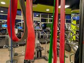 Red And Colorful Elastic Bands In A Modern And Well Equipped Gym For Getting Fit And Exercise Stretc poster