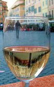 picture of italian food  - Picture taken through a wine glass in a piazza in Rome Italy. The focus is on the glass showing the refracted image of the background in the liquid. Interesting perspective of typical Italian scene.