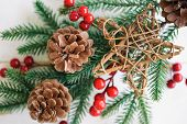 Christmas White Wood With Pine Cones Or Conifer Cone, Red Holly Balls, Wooden Star, In Christmas Con poster